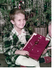 Bill Reynolds as a boy at Christmas