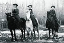 3 women sitting astride on horseback