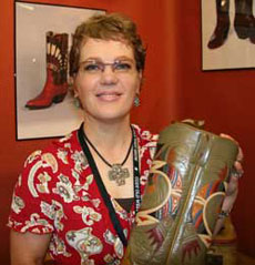 Lisa Sorrell holds a pair of her custom made boots